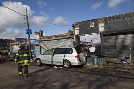 reportedly: NEW YORK - October 31: Homes sit smoldering after Hurricane Sandy  in the Far Rockaway area . Over 50 homes were reportedly destroyed in a fire during the storm on October 30; 2012 in New York City; NY Editorial