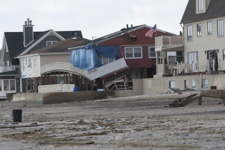 NEW YORK - October 31:Destroyed homes in  Far Rockaway after Hurricane Sandy October 29, 2012 in New York City, NY Stock Photo - 16179695