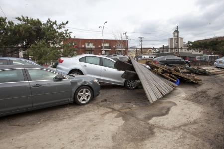 zonefarockaway: NEW YORK - November 1: Crashed cars after Hurricane Sandy  in the Far Rockaway area  on October 30, 2012 in New York City, NY