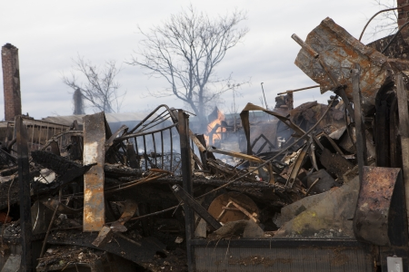 reportedly: NEW YORK - October 31: Homes sit smoldering after Hurricane Sandy on October 30; 2012 in the Far Rockaway area . Over 50 homes were reportedly destroyed in a fire during the storm on October 30; 2012 in New York City; NY