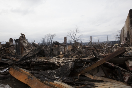 NEW YORK - October 31: Homes sit smoldering after Hurricane Sandy on October 30; 2012 in the Far Rockaway area . Over 50 homes were reportedly destroyed in a fire during the storm on October 30; 2012 in New York City; NY Stock Photo - 17326425