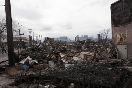 NEW YORK - October 31: Homes sit smoldering after Hurricane Sandy on October 30; 2012 in the Far Rockaway area . Over 50 homes were reportedly destroyed in a fire during the storm on October 30; 2012 in New York City; NY