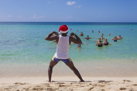 Aqua  aerobics  instructor in front of a group of people in Caribbean sea