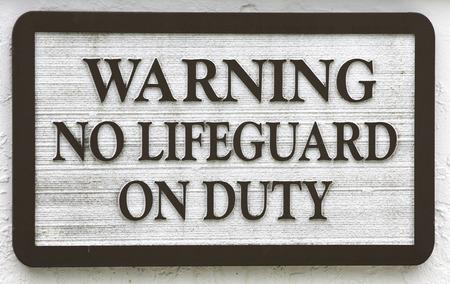 short phrase: Sign: Warning no lifeguard on duty
