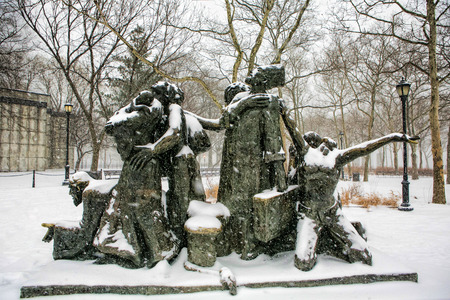 NEY YORK - January 21:Visitors at the Immigrants - Sculpture At Battery Park on January 21 2014.It was created by Artist Luis Sanguino in 1973 dedicated to immigrants to America.