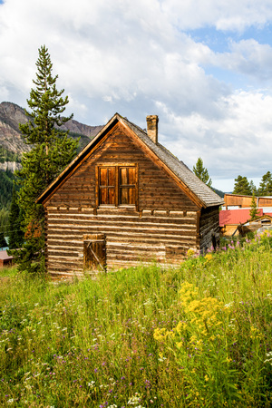 pioneers: Old Farm House in Rural Landscape