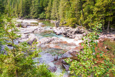 mcdonald: Glacier National Park. Turquoise river flowing towards Lake McDonald Stock Photo