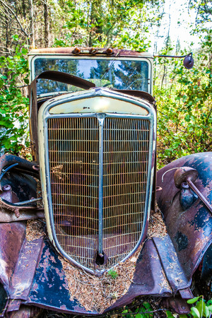 salvage yards: Kalispell - August 2:  Old cars and trucks in the  junk yards August 2, 2015 at Kalispel, MT.