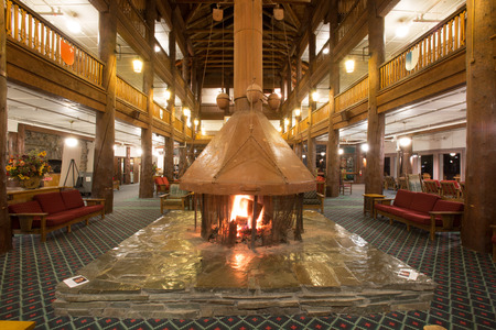 outdoor fireplace: National Historic Landmark - Many Glacier Hotel interior Editorial