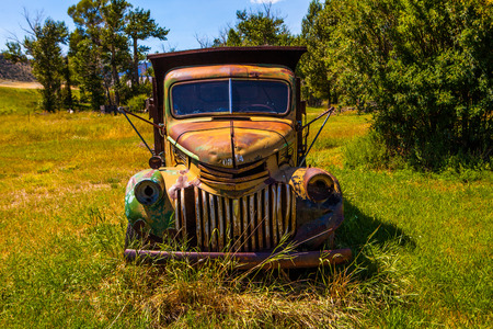salvage yard: Kalispell - August 2:  Old cars and trucks in the  junk yards August 2, 2015 at Kalispel, MT.