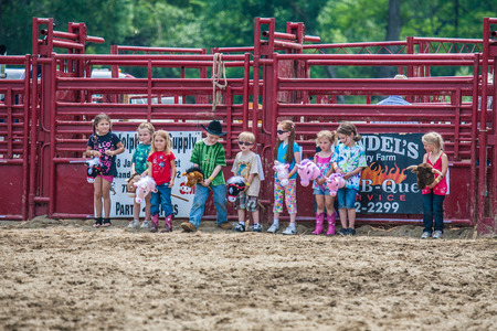 bucking bull: Cowboy Participating Competition. Championship Rodeo Editorial