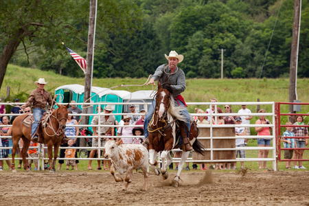 mack: Ellicottville, New York - July 4 : Cowboy Participating Competition. Championship Rodeo, Located in the beautiful Enchanted Mountains that surround Ellicottville New York, USA on July 4 2011