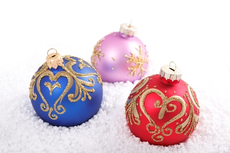 Christmas decorations in the snow, on a white background  Stock Photo - 15276337