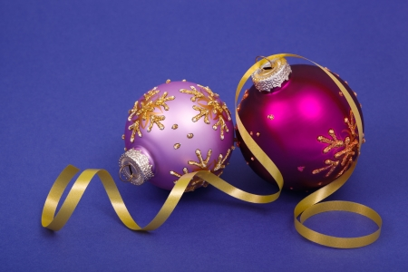 Christmas decorations with a yellow ribbon on a blue background  photo