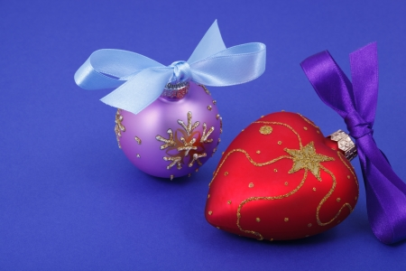 Christmas decorations with bows on blue background  photo