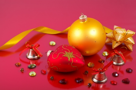 precious stones: Christmas decorations with precious stones and ribbons on a red background  Stock Photo