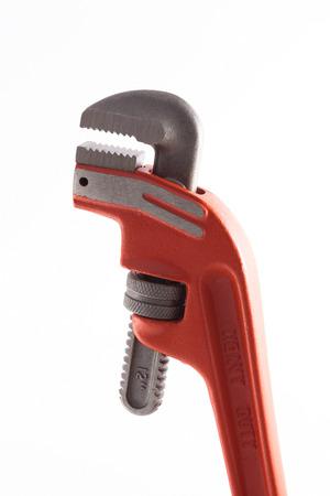 Orange Pipe Wrench Isolated on white background  photo