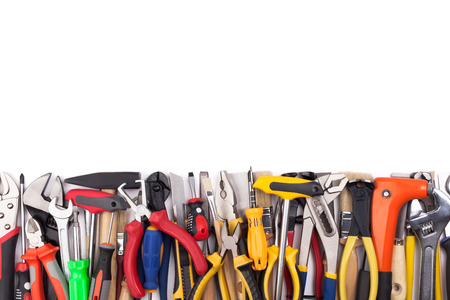 Work tools lined up in a straight line on white background