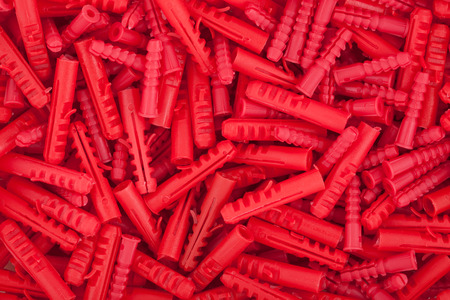 Red plastic dowels for concrete wall photo