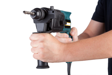 laboring: Man holding rotary hammer on white background. Stock Photo