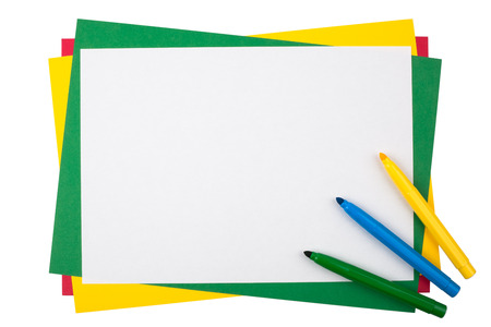 roster: Colored markers on a frame from sheets of multicolored paper isolated on white background.