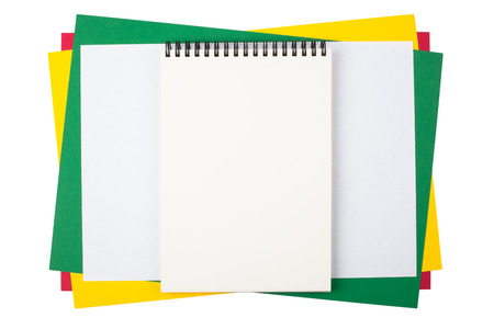 Notebook on sheets of colored paper imitating a frame. Composition isolated on white background. photo