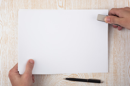 formalization: Paper binding on a wooden texture imitating a office desk. Stock Photo