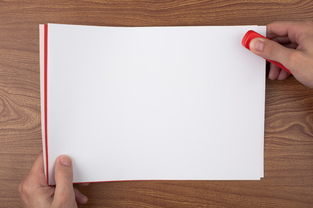 Paper binding on a wooden texture imitating a office desk. Stock Photo