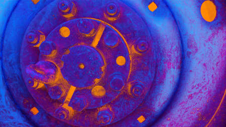 Abstract technical background, orange blue colored. Heavy machinery, piece of iron with bolts