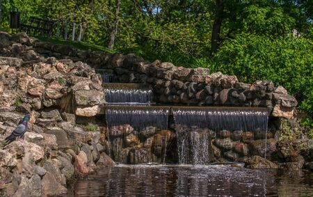 Small Water Cascade In The City Park. Banco de Imagens