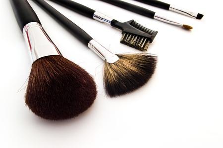set of professional makeup brushes on white background Stock Photo