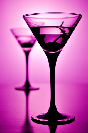 Martini glass on purple background (shallow depth of field) photo