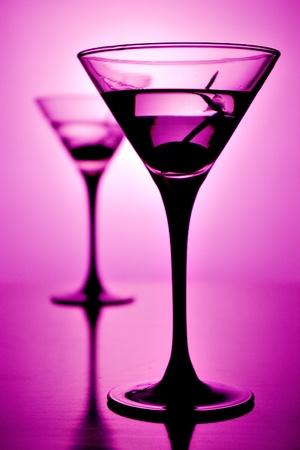 Martini glass on purple background (shallow depth of field) Stock Photo - 8381704