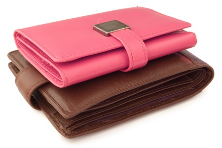 creditcards: pink wallet on top of a brown wallet