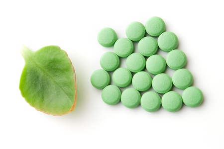 Green leaf and pills on white background Stock Photo - 8631481