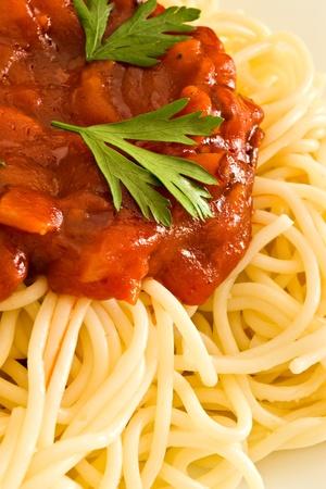 Close-up of hot tomato sauce on spaghetti photo