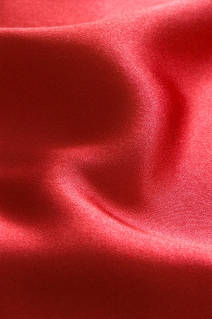 softly: red satin fabric background