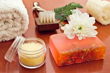 sopa: towell brush loofah sea-salt sopa and flower arrangement Stock Photo