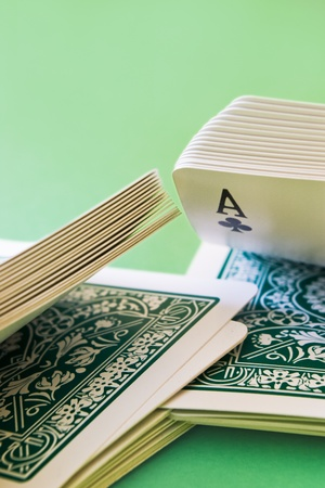 close-up of playing cards shuffled with an ace