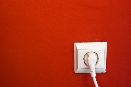 electric outlet on red wall photo