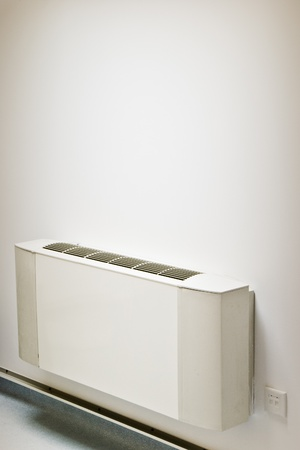 interior air-conditioner unit on white wall photo