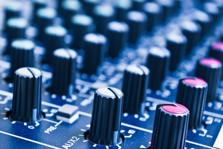 audio mixer knobs with shallow depth of field Stock Photo - 9297210