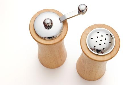 wooden salt and pepper shaker on white photo
