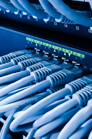 network switch: patch cords and network switch Stock Photo