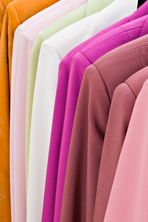 colored woman clothes on hangers Stock Photo - 9586755