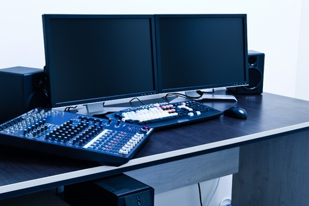 music production: broadcast editing station blue toned Stock Photo