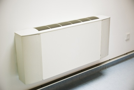 Ventilation: air-conditioner unit on white wall