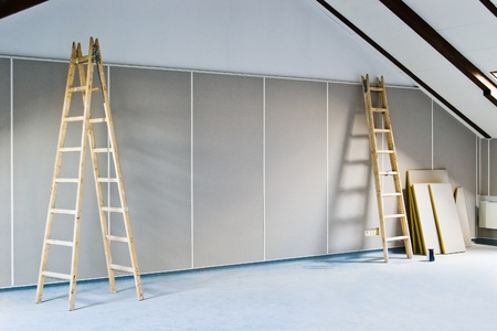 renovation interior with two ladders and wall