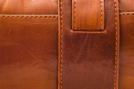 rawhide: sewed brown leather background for texture Stock Photo