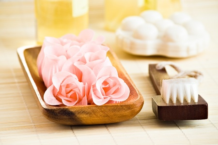 beauty items with flower soap brush and shampoo with shallow depth of field photo
